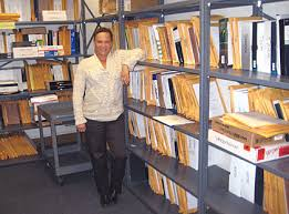 Paper is out  digital is in  when it comes to     University of California  Berkeley Laurie Roach with shelves of printed dissertations