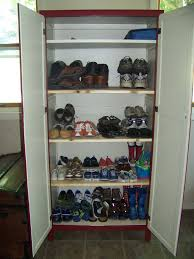 Shoe Storage Furniture by White Garage Shoe Storage Cabinet With Ample Shelving Inside