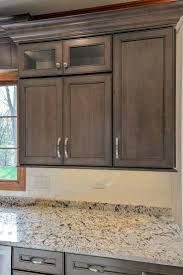 warm brown kitchen cabinets in maple featuring cocoa glaze finish