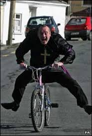 Careful now, Belfast man James Hillock rides a bike at the Father Ted festival. - _44453076_tedbikepa203