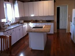 White Kitchen Cabinets With Black Granite Countertops by Kitchen Level 2 River White Granite White Kitchen Cabinets With