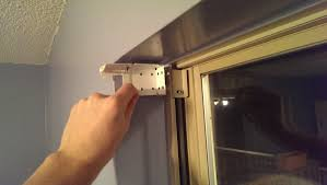 installing blinds in a window did it myself