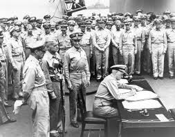 Admiral Nimitz signing the peace treaty on the Missouri