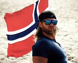 Norwegian Navy officer Lasse Matberg  who looks like a      Viking     Lasse posed next to a Norwegian flag in a tight T shirt to show his