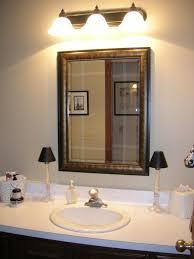 bathroom vanity lights bronze wall led lights above stylish mirror
