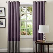 purple fabric curtains with grey bottom part on steel rod combined