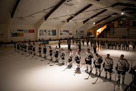 Former Wisconsin Coach Mike Eaves Is Rebuilding at Division III St     The New York Times The Oles during the national anthem before facing Gustavus Adolphus  rear  Credit Tim Gruber for The New York Times