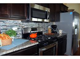 captivating kitchen stone backsplash dark cabinets white tile