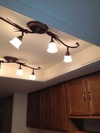 Track Lighting For Kitchens by Changing The Kitchen Fluorescent Box Light Fixtures Like The Use