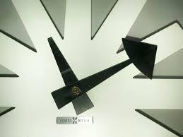 asterisk clock by irving harper for howard miller 1960s for sale