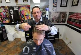 barber miguel ayala of pete u0027s barber shop in valparaiso cuts the