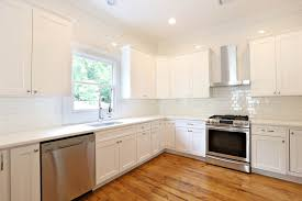 off white cabinets white subway tile large kitchen design with
