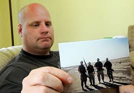 Former West Virginia National Guardsman Russell Powell holds a photo of him ... - rad_070909_l_4_russell_powe_500