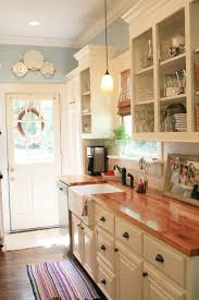 kitchen style ivory flat cabinet butcher block countertop country