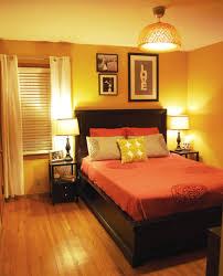 bedroom orange feature wall mood colors bright orange paint room