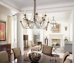 seeded glass chandelier family room mediterranean with fireplace
