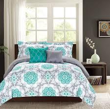 grey comforter king wooden bed frame white floor tiles floral