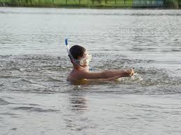 child bathing in river|Dreamstime.com