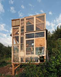 a tiny garden house built from old window panes in stuttgart