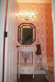 remodelaholic coral trellis wallpaper powder room