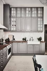 smart kitchen layouts solving the small spaces in modern houses gray kitchen cabinets for kitchen layouts l shaped with white backsplash tile