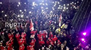 syria jubilant syrians gather for christmas celebration in west