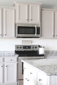 How To Paint Veneer Kitchen Cabinets A Tutorial On How To Paint Cheap Laminate Cabinets With No Prep