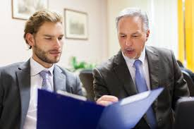 business executives reviewing resume document jpg