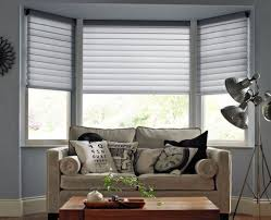 bay windows using grey blinds and bottom shutters fantastic and