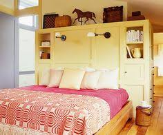 Bookshelves As Headboard by Bhg I Bookshelves In Place Of Headboard Especially Good For