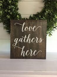 love gathers here love gathers here sign love gathers