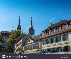 low angle view of medieval german village with a cathedral looming