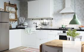 White Country Kitchen Cabinets An Off White Country Kitchen With Black Worktops Combined With