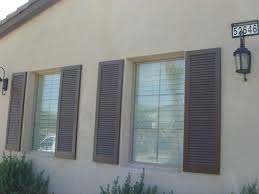 Lowes Home Decor by Decorating Nice Bahama Shutters Lowes With Beige Wall Decor For