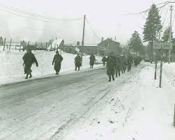 U.S. Army reinforcements enter Bastogne on Dec. 27, 1944, after WWII battle.