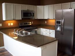 White Kitchen Cabinets With Black Granite Countertops by Best Kitchen Cabinet And Countertop Combinations Outofhome