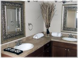black silver carving mirror frames on pale beige wall added by