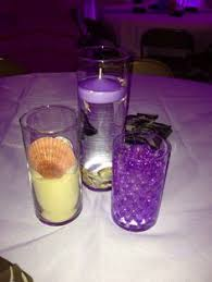 Purple Floating Candles For Centerpieces by Purple Water Centerpiece W Floating Candles Instead Of Flowers