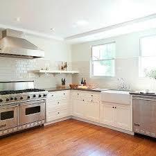 Cream Subway Tile Backsplash by White Viking Range And Hood Transitional Kitchen
