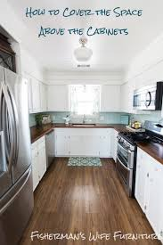 space between kitchen cabinets and ceiling should kitchen cabinets