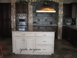 Antiqued Kitchen Cabinets by Lynda Bergman Decorative Artisan White Kitchen Cabinets To A Hand