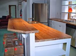 two tiers kitchen island table with butcher block top and built in