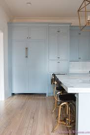 a classic vintage modern kitchen blue gray cabinets inset shaker