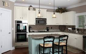 cream color of cooker hood by double black barstools white