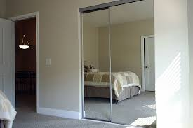 white doors with glass panels white and panels and mirrored sliding closet doors mirrored