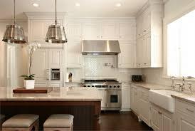 blue tile backsplash kitchen gas cooktop butcher block countertop