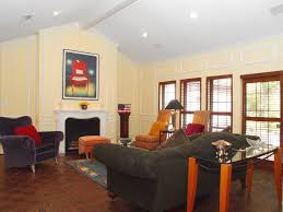 Exposed Beam Ceiling Living Room by Traditional Living Room With Chair Rail U0026 Cathedral Ceiling In