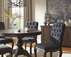 5 piece round dining table set with upholstered side chairs by