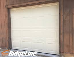 The Overhead Garage Door Company by Mid America Steel Model 2500 Non Insulated Color Almond 8x7