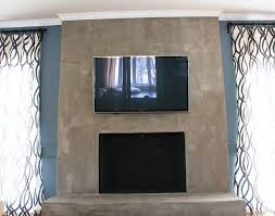 concrete industrial fireplace remodel meets cozy chic angie u0027s list